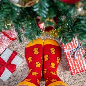 Person standing by Christmas wearing Lussebulle socks